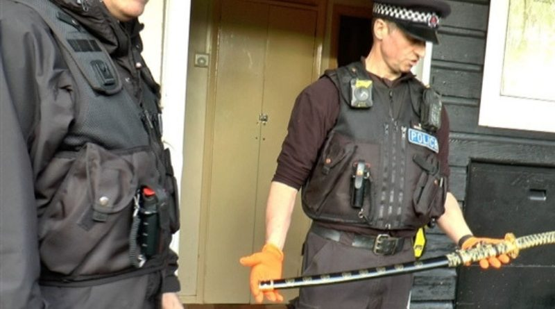 Police raid Maidstone flat.